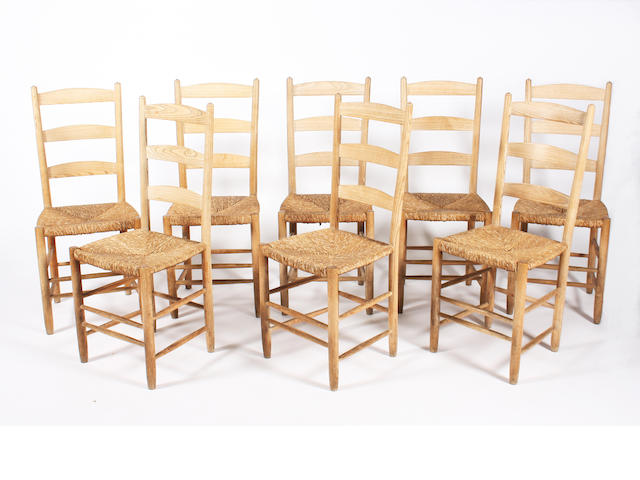 A set of eight turned ash frame ladderback chairs by Edward Gardiner, circa 1950, designed by Ernest Gimson, 'The Bedales'