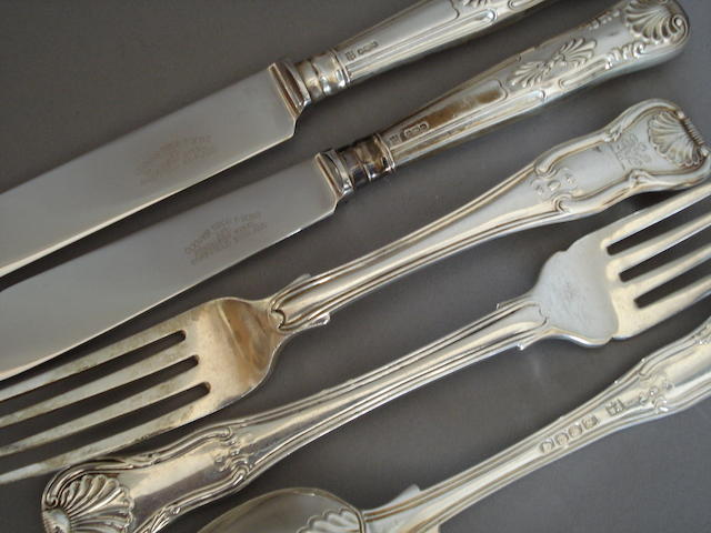 A composite canteen of George III/William IV Kings Variant pattern flatware and cutlery, mixed dates 1817 - 1827