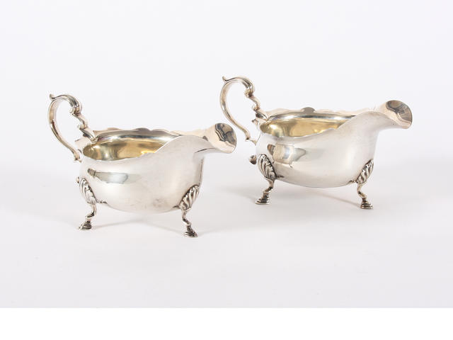 A pair of silver sauce-boats By C & S Ltd, Birmingham, 1913,  (2)