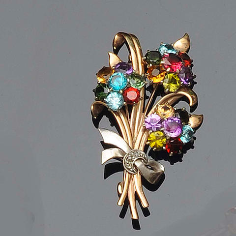 A multi-coloured gem set flower brooch