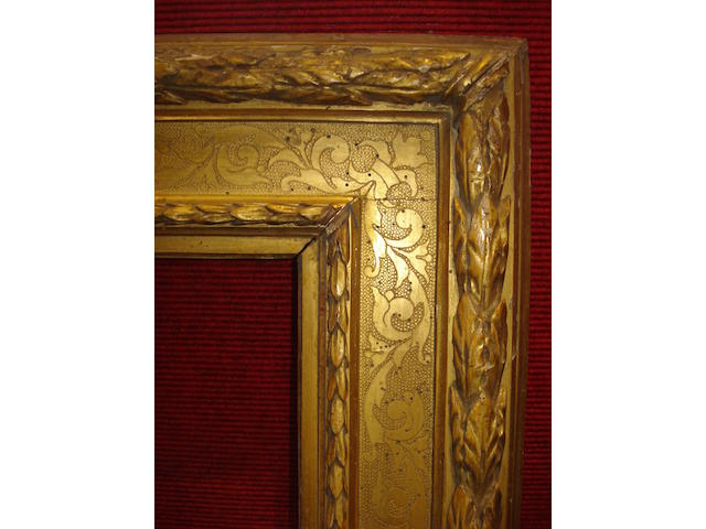 An Italian 19th Century carved and gilded cassetta frame, together with a Spanish 17th Century style polychromed cassetta frame and a Spanish 17th Century style gilded cassetta frame, (3).