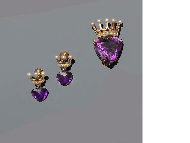 An amethyst and seed pearl brooch and earring suite