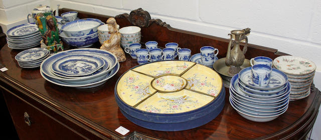 A collection of Chinese Export blue and white tea, coffee and dinner wares, including meat plates and two bowls, nine Chinese 'famille rose' rice bowls and stands, pair of Chinese figures of lion dogs, cased cloisonne enamel hors d'ouevres set and four other items.