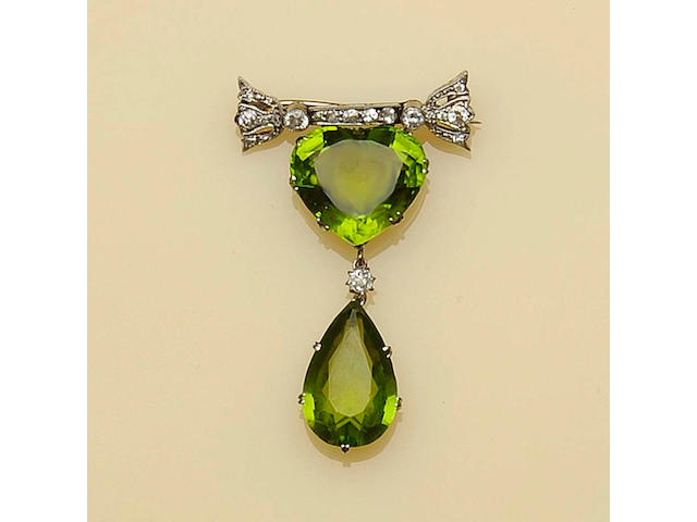 A peridot and diamond pendant/brooch