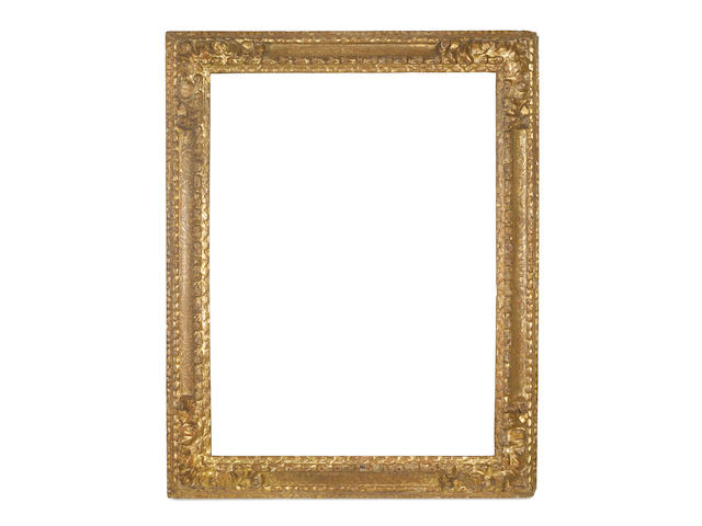 A Spanish 17th Century carved and gilded frame