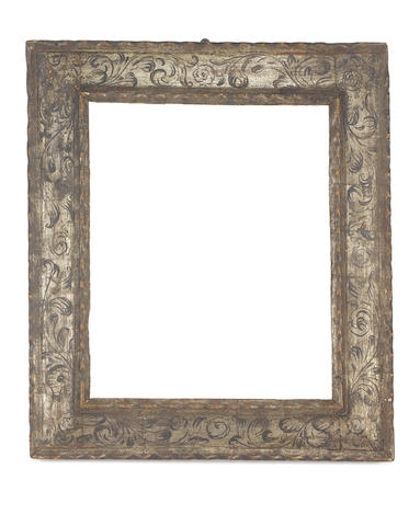 A Spanish 17th Century carved, silvered and polychromed ripple moulding frame