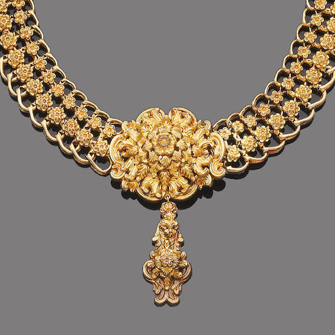 A gold necklace and earring suite, (2)