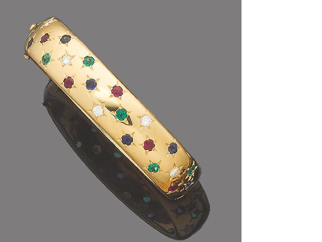 A gem-set and diamond hinged bangle, by Cartier