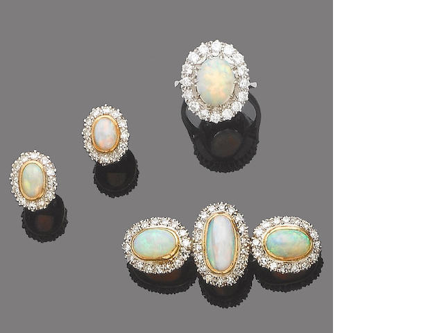 An opal and diamond brooch, ring and earring suite (3)