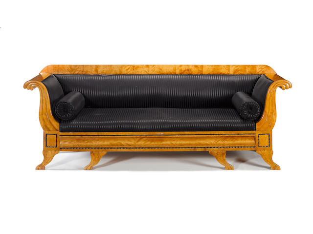 A North European 19th century stained birch and ebonised Biedermeier sofa