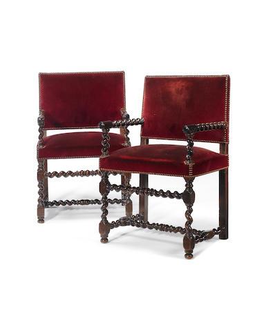 A pair of Louis XIII walnut fauteuils