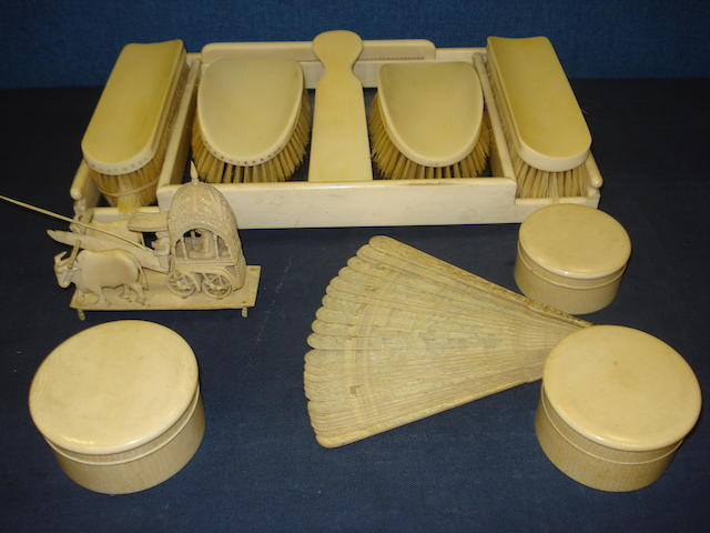 An early 20th Century ivory dressing table brush set on a rectangular tray,