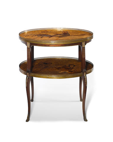 A French late 19th/early 20th century Transitional style ormolu-mounted satiné and marquetry two-tier occasional table by Louis Majorelle, Nancy