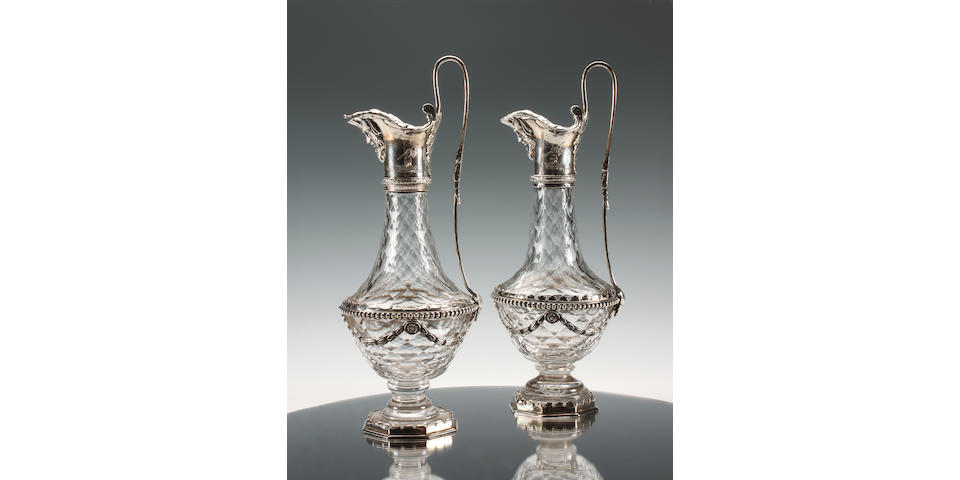 A George III pair of silver mounted cut glass oil & vinagar bottles by Matthew Boulton & John Fothergill, Birmingham 1773