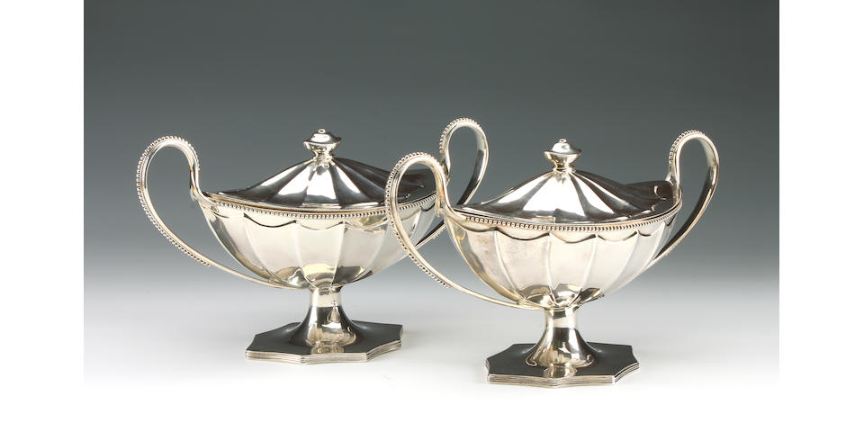 A George III pair of 2 handled oval pedestal tureens by John Langlands I & John Robertson I,  Newcastle 1788