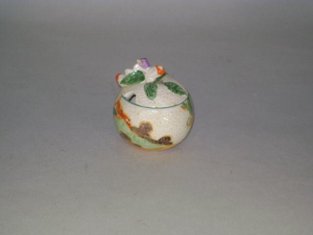Clarice Cliff - Secrets moulded preserve jar and cover, chip to finial