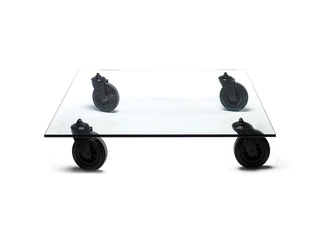 Gae Aulenti for Fontana Arte, a 'Tavolo Con Ruote' table, designed 1980 glass top with rubberised and black metal feet