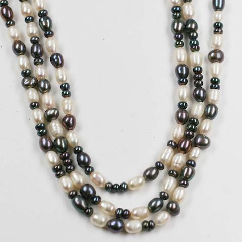 Three matching continuous black and white freshwater cultured pearl necklaces. (3)