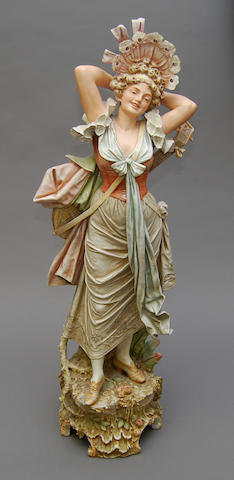 A very large Austrian porcelain figure of a lady with lute
