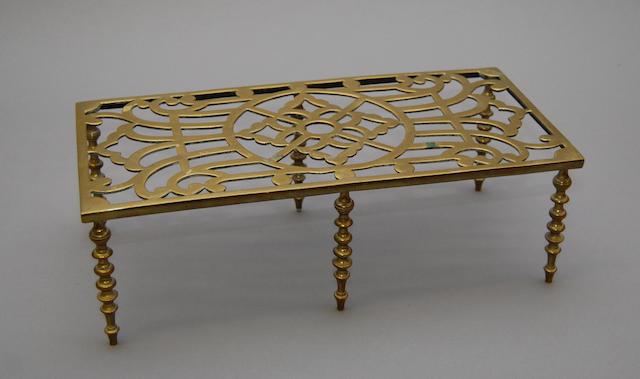 A brass trivet