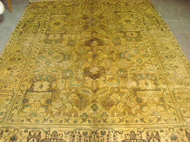 A Tabriz carpet North West Persia, 292cm x 207cm