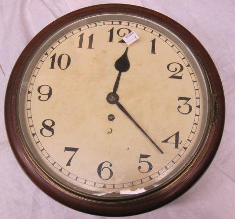"A Victorian mahogany cased wall clock, the 12"" painted dial with single fusee movement and brass bob pendulum and key."
