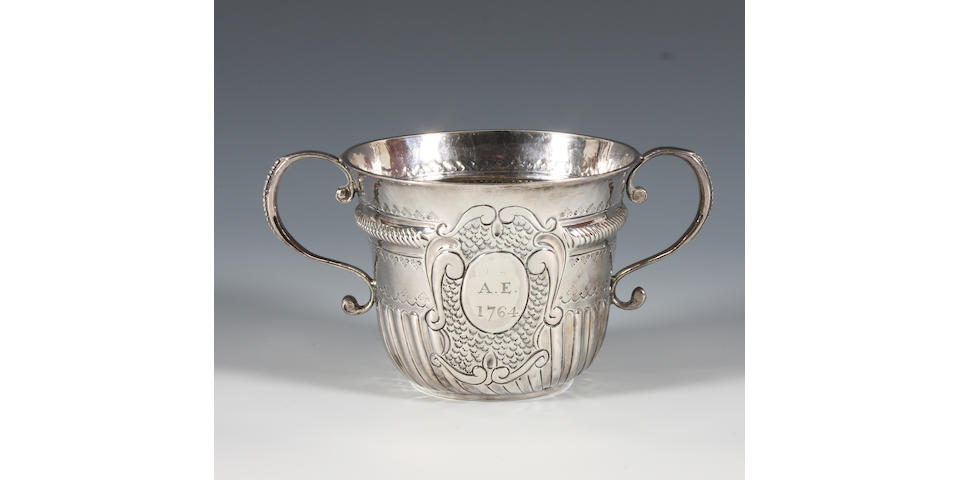 A Queen Anne Britannia Standard silver porringer By John Corey, London, 1704,