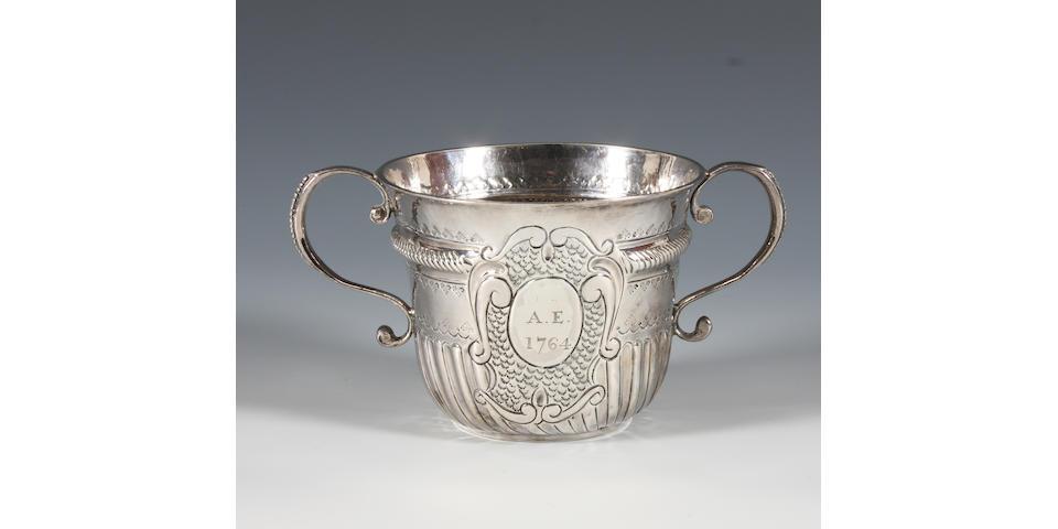 A Queen Anne Britannia Standard silver porringer By John Corey, London, 1704,