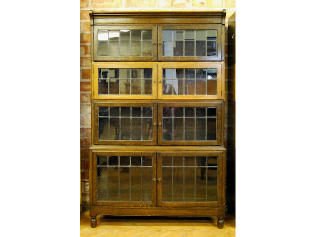 Two oak Minty stacking bookcases, early 20th Century Each bearing ivorine maker's label