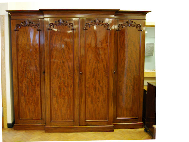 A large and impressive early Victorian mahogany breakfront wardrobe