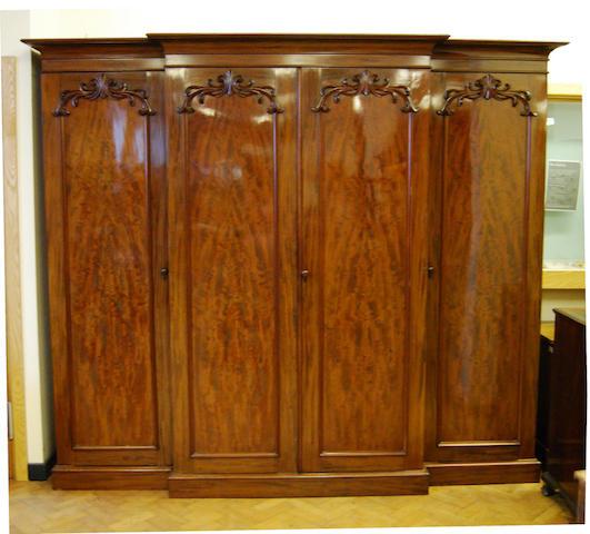 A large and impressive early Victorian mahogany breakfront wardrobe