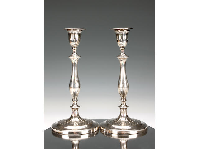A George III pair of baluster candlesticks by John Parsons & Co., Sheffield 1792