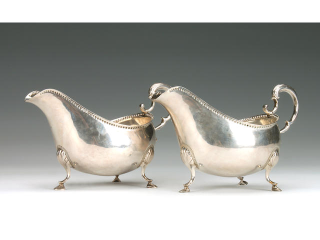 A George III pair of Irish gravy boats by Matthew West, Dublin 1787