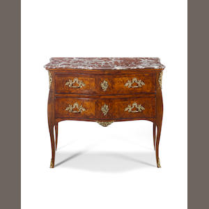 A French part-18th century Louis XV burr elmwood and walnut commode