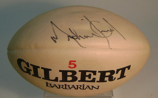 A rugby ball autographed by Michael Jackson and Shirley Bassey, 1988,