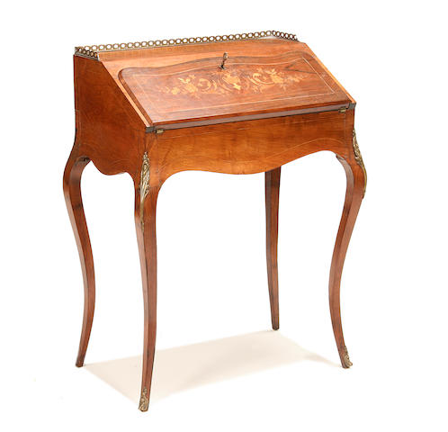 A late 19th century rosewood and marquetry bureau de dame  in the Louis XV style