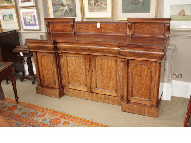 An inverted, break-front Victorian mahogany sideboard