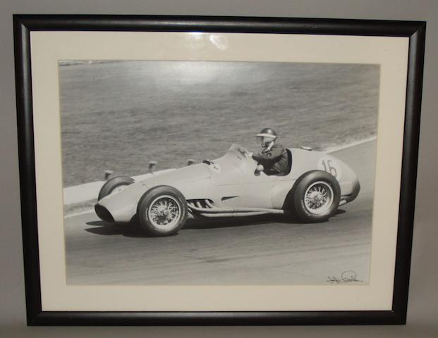 A photograph of Mike Hawthorn / Ferrari at the 1955 British Grand Prix, Silverstone by John Fairlie,