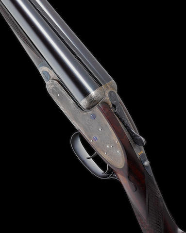 A lightweight 12-bore self-opening sidelock ejector gun by J. Purdey & Sons, no. 24260 In a leather case with J. Purdey & Sons trade-label