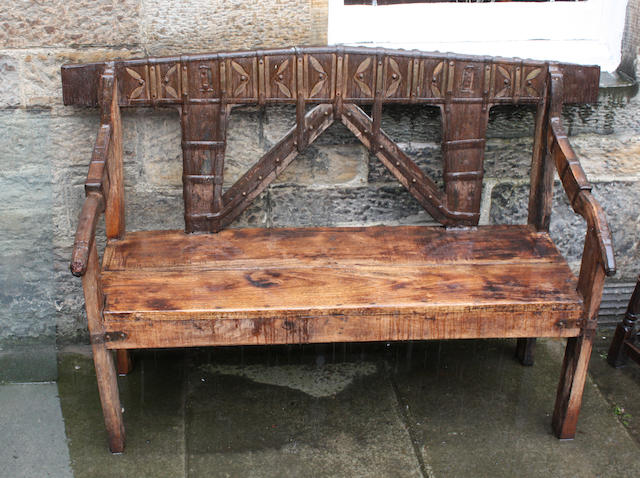 An Indian hardwood and iron bound bench