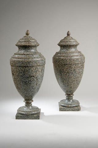 A pair of 19th Century green porphyry urns