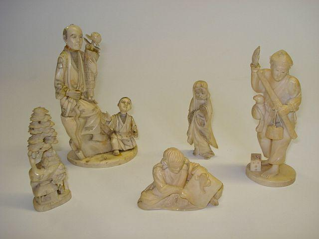 A group of five carved and sectional ivory okimono