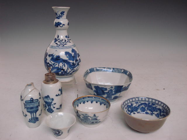 A near pair of Chinese blue and white bottle vases, another bottle vase, and four various tea and rice bowls Mainly 18th century