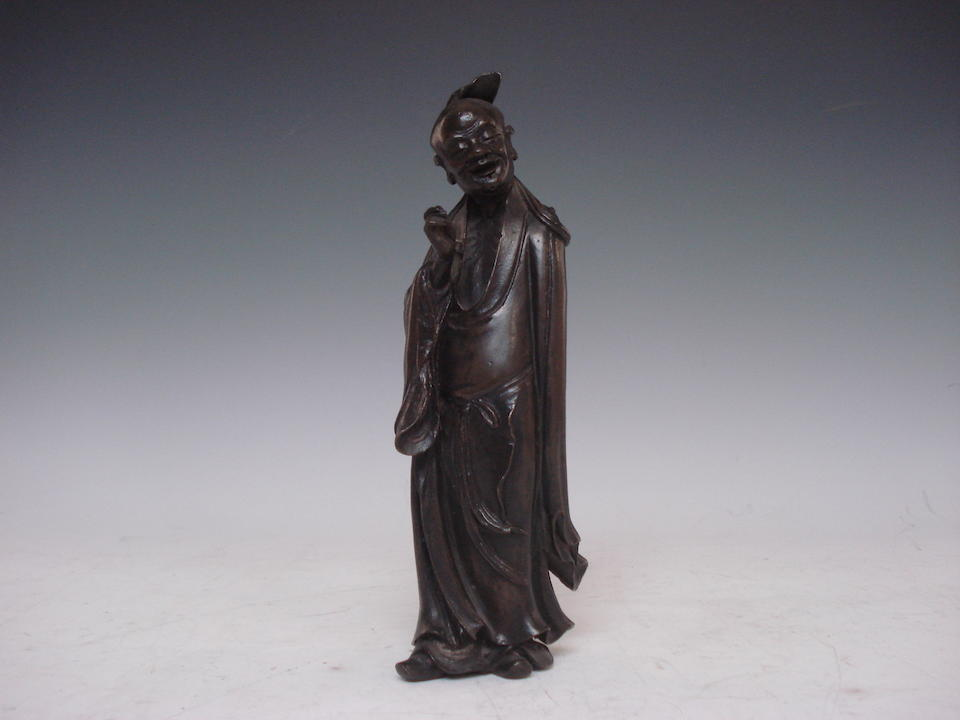 A standing bronze figure of a Luohan Probably Ming