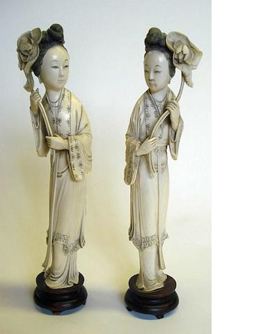 A pair of Chinese ivory figures of ladies