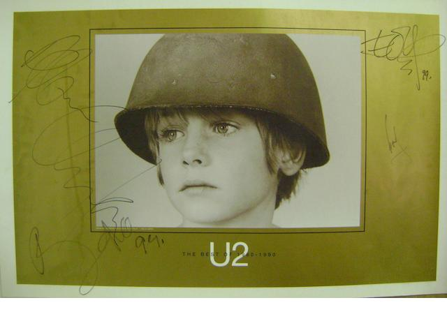An autographed poster for the album 'The Best Of 1980-1990' by U2,