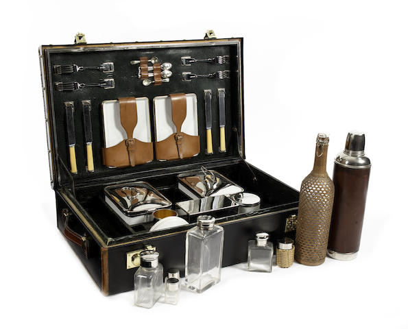 Asprey, New Bond Street, London, fine and rare four person leather cased suitcase , sandwich and drinking picnic set.