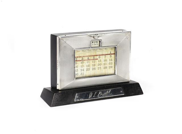 An SS Jaguar solid silver hallmarked desk calendar, 1936,