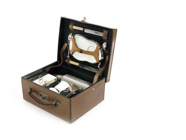 Early  fine honey leather cased Barratt, picnic set makers to the Royal Family, from Mayfair London,