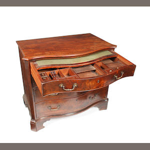 A George 111 serpentine mahogany dressing chest.
